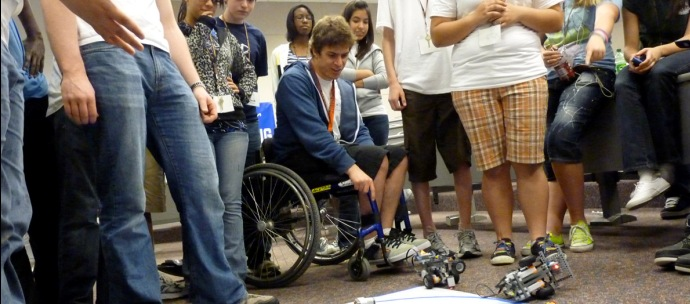A student in a wheelchair integrated in a group of STEM students